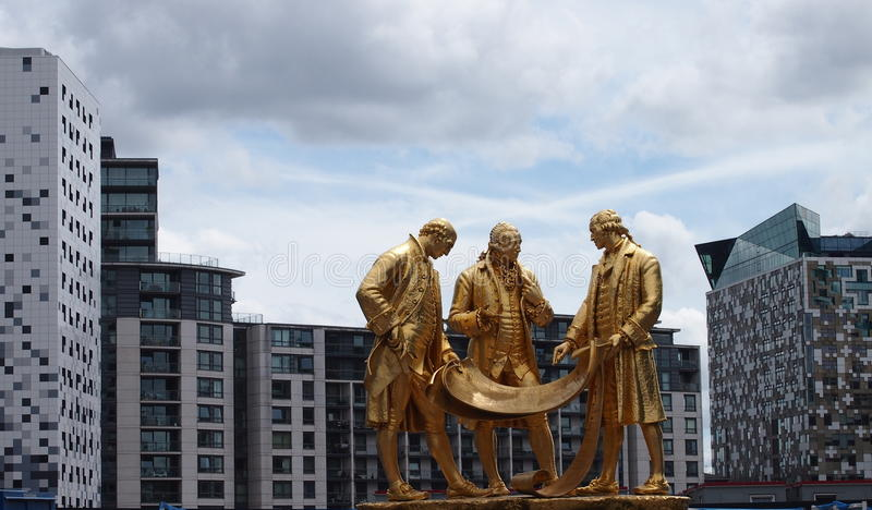 Boulton, Watt and Murdoch Statue in the centre of Birmingham, England. The gilded bronze statue on Broad Street, Birmingham, UK, depicts the three pioneers of stock photos