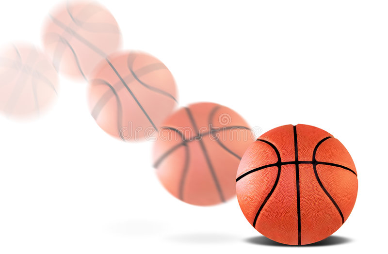 Bouncing basketball. A basketball bouncing with a motion blur stock images
