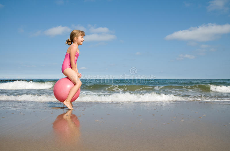 Download Bouncing at the beach stock photo. Image of little, summer - 14753692