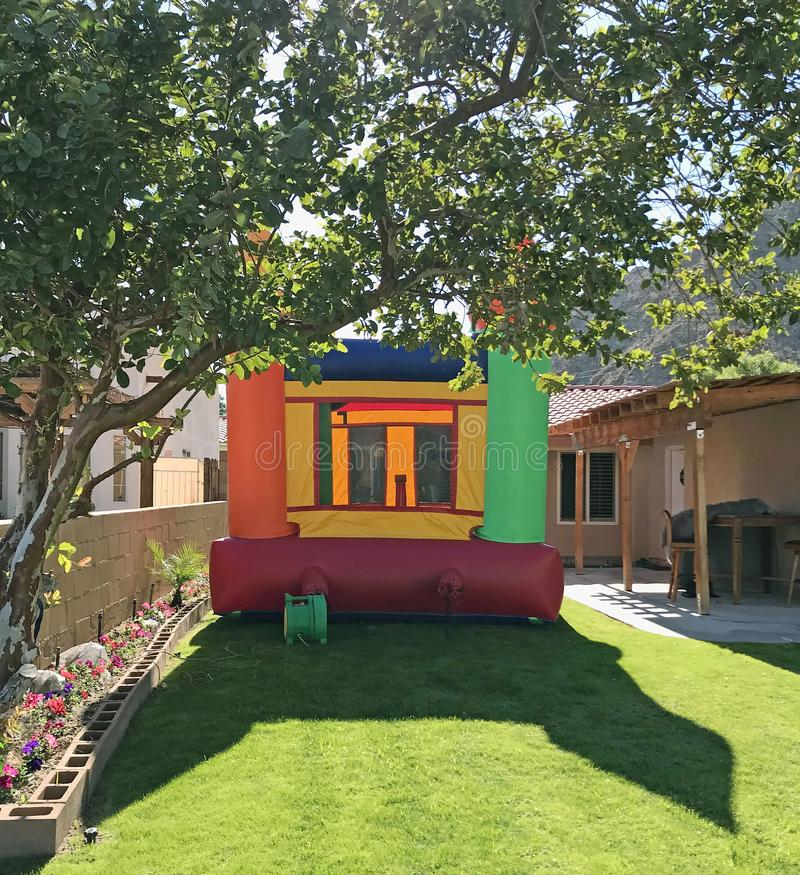 Bouncy Castle For Kids Birthday Party. Inflatable bouncy castles are popular at children`s birthday parties. This house is very colorful stock image
