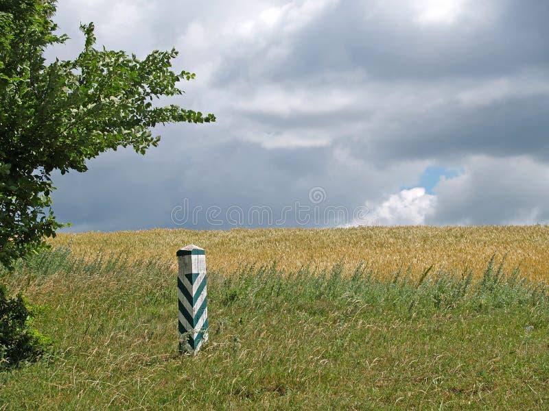 Boundary column on border of fields royalty free stock photo