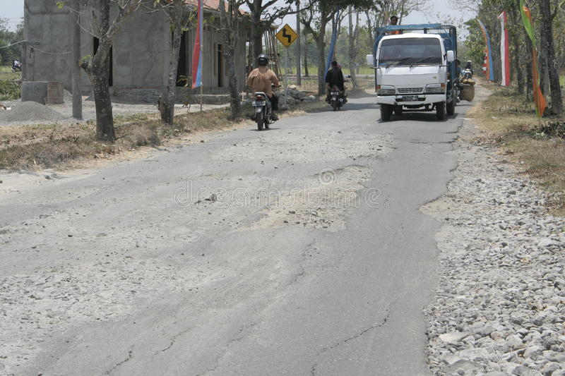 The boundary district. City road infrastructure leprosy in Sukoharjo often damaged because of impassable trucks haul exceed the limit stock image
