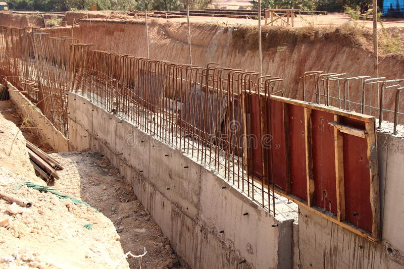 Boundary. Making a concrete wall for separate the plot as its boundary stock image