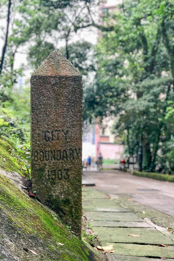Boundary Stone of City of Victoria HK 1903. One of 7 boundary stones erected by HK Government in 1903 to mark the limits of the City of Victoria, the capital of stock images