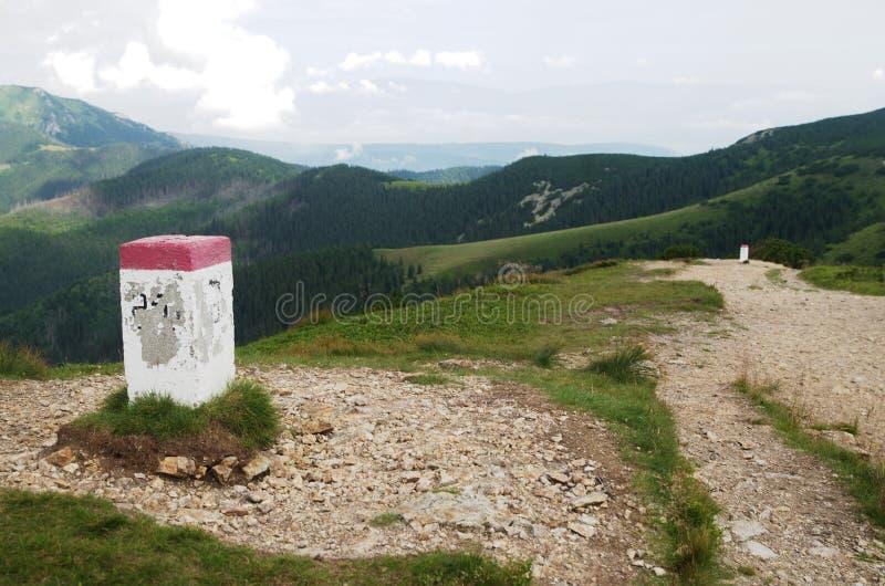 Boundary stone with Poland in Rohace western Tatra mountains, Slovakia stock photography