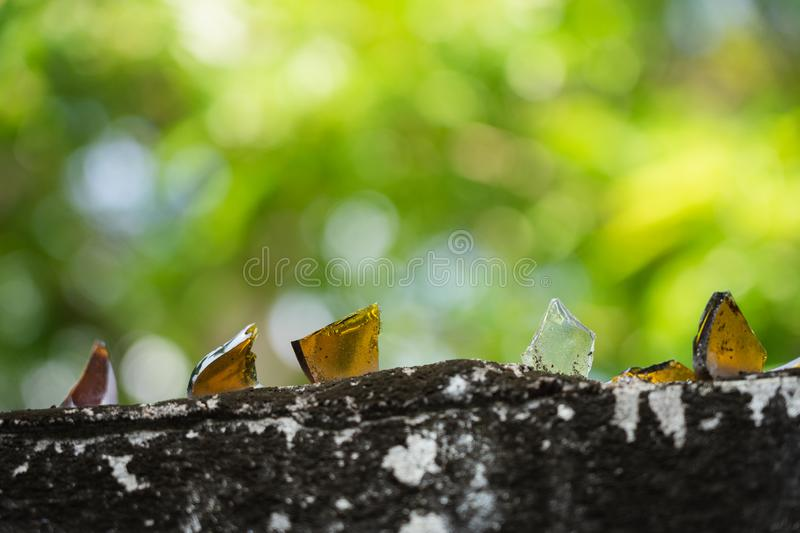 Boundary wall around the house Additional glasses are keen to prevent theft. The concept of anti-grip traps thief. Boundary wall around the house Additional stock photos