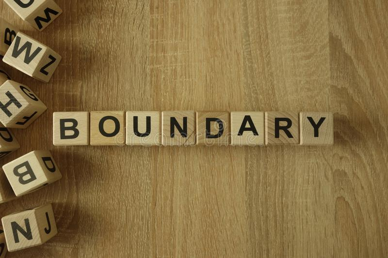 Boundary word from wooden blocks. On desk royalty free stock image