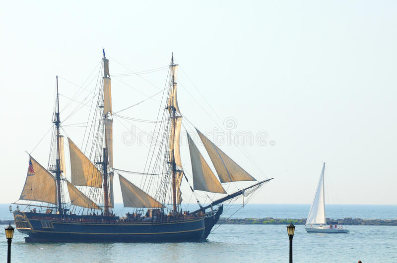 Bounty at broadside. Broadside view of The H.M.S. Bounty (replica built in 1962) as it sails in the Parade of Ships that began the 2010 Tall Ships Festival (July royalty free stock image