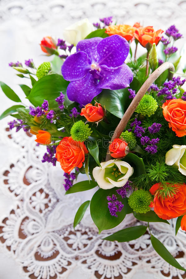 Bouqet. Bouquet of different colored flowers on decorated white background royalty free stock image
