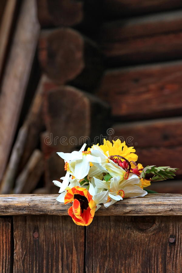 Bouqet of flowers. On an old porch royalty free stock images