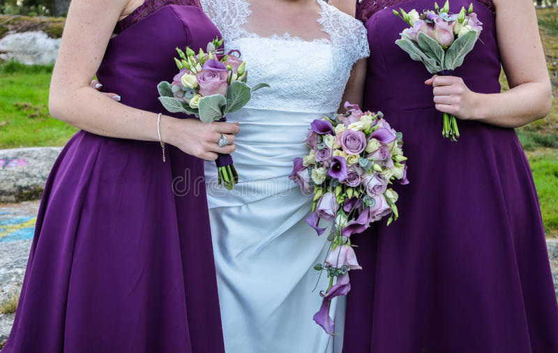 Bouqets for a wedding. A bouqet for the bride and bridesmaids with a Beautiful mix of silver and Purple stock photos