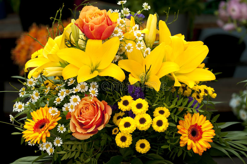 Bouquet. Bouqet with yellow lillies at a market stall royalty free stock photos