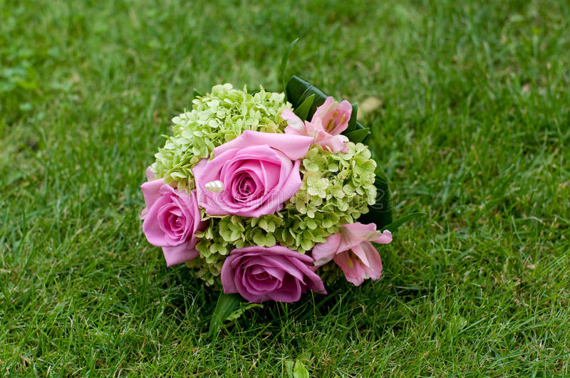 Bouquet. With pink roses and green guelder rose stock photos