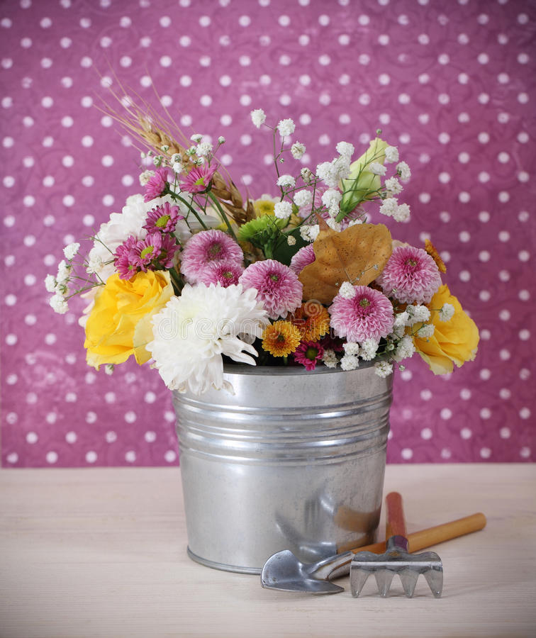 Download Bouquet Of Autumn Flowers In The Iron Pot Stock Image - Image of arrangement, bunch: 21259503