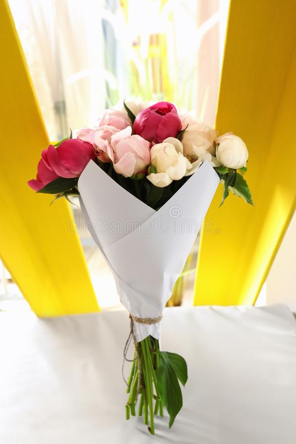 Bouquet Of Beautiful Colorful Peony Flowers On Leather Chair Stock ...