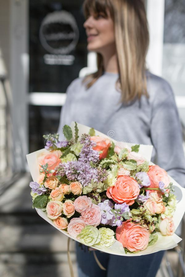 Bouquet of beautiful flowers in women`s hands. Floristry concept. Spring colors. the work of the florist at a flower. Shop royalty free stock photos