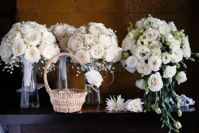 Bouquet for the bride, bridesmaids with basket of rose petals royalty free stock photography