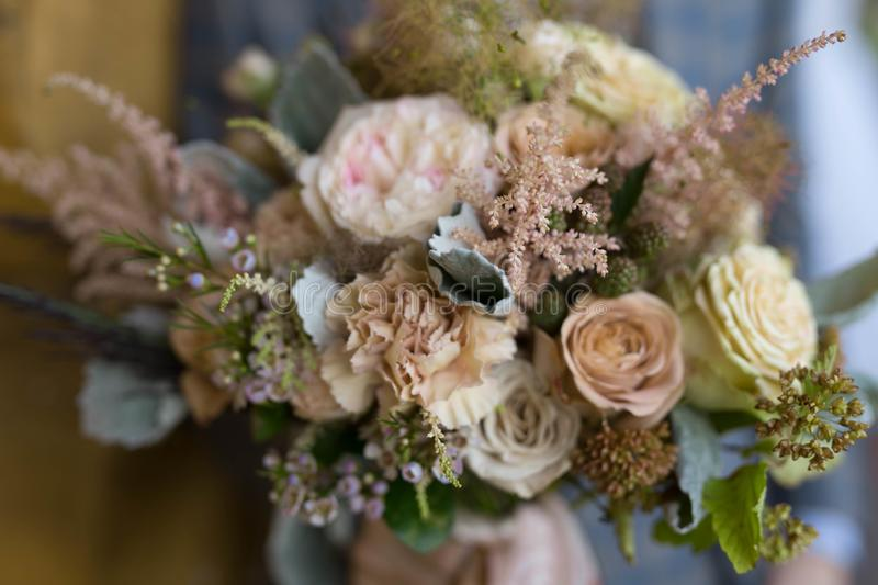Bouquet for the bride from different flowers. Newlyweds hold a bouquet for the bride from different flowers stock photography