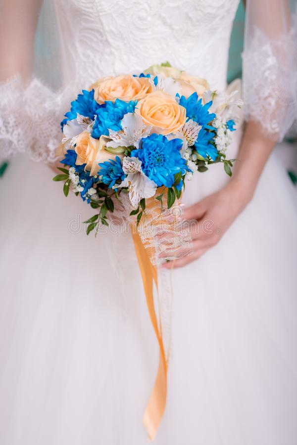 Bouquet of the bride in the hands of wedding rings. the bride is holding a bouquet. royalty free stock photos