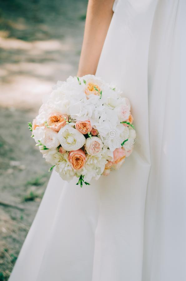 Bouquet in the bride`s hand stock photography