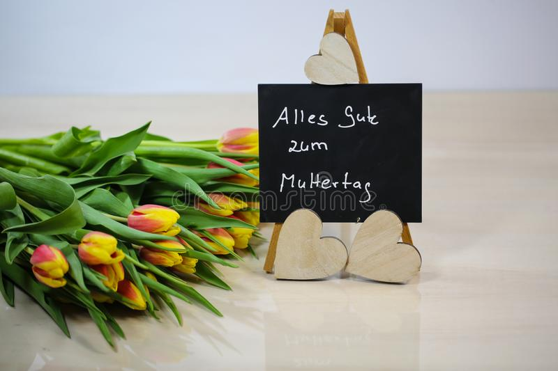 Bouquet with chalk board, Happy Mother`s Day stock photo