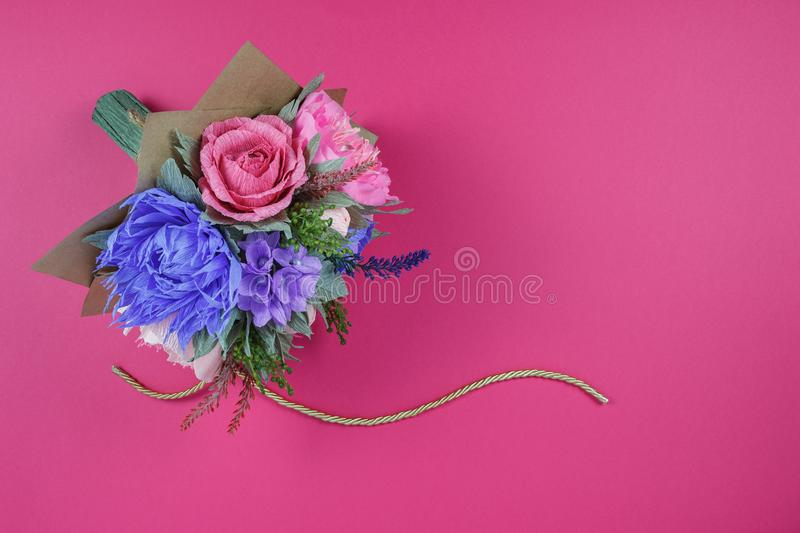 A bouquet of colorful paper flowers on a magenta background as a backdrop for a postcard, invitation letter and etc.  stock images
