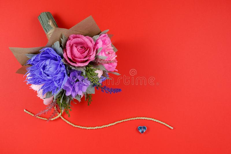 A Bouquet Of Colorful Paper Flowers And A Small Blue Heart On A Red ...