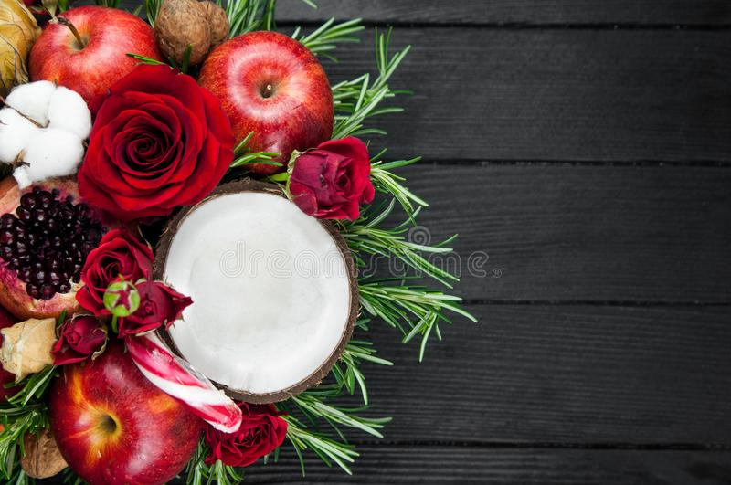 Fruit bouquet with apples, roses and pomegranat. royalty free stock photography