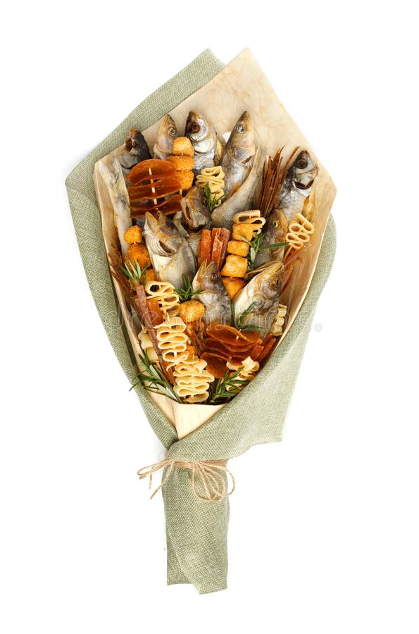 Free Bouquet Consisting Of Salted Stockfish Of Different Breeds, Slices Of Dried Squid And Other Fish On A White Background Stock Photo - 137242190