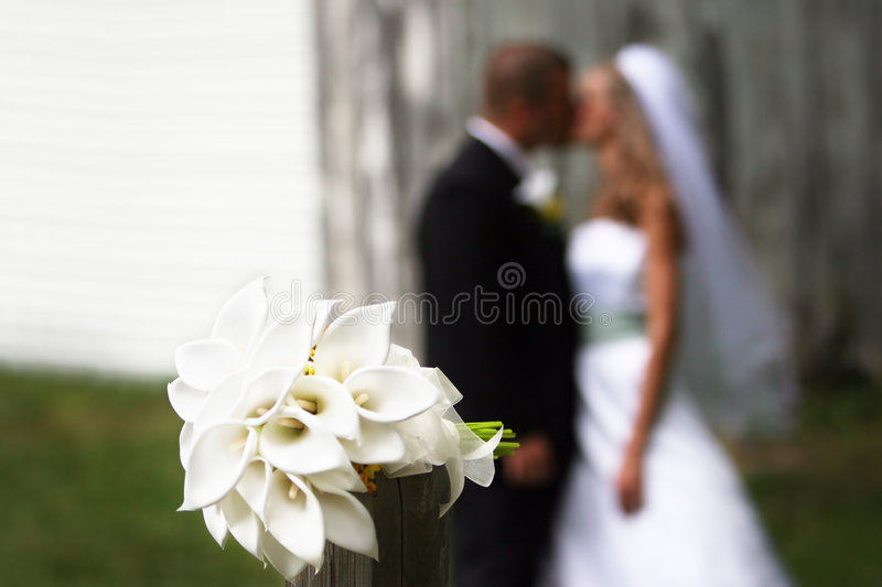 Bouquet with couple kissing stock images