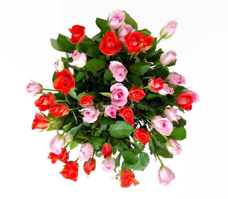 Bouquet of cute red and pink roses. Delicate bouquet for a woman royalty free stock images
