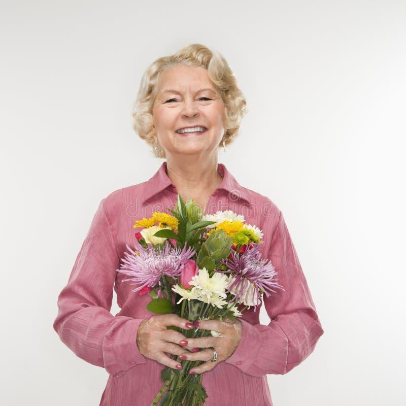 Bouquet de fixation de femme. photo stock
