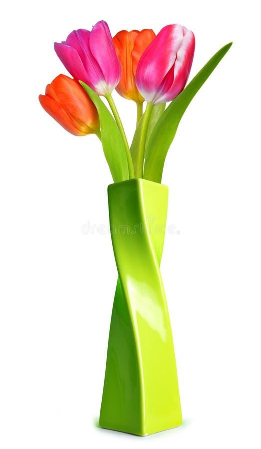 Bouquet des tulipes colorées dans le vase vert photos libres de droits