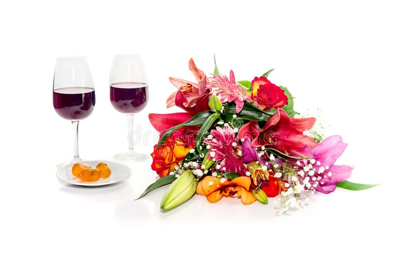 Bouquet of diverse flowers, wine and kumquat close-up on a white royalty free stock image