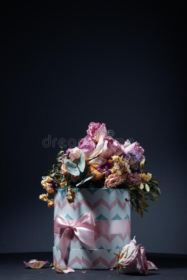 Bouquet Of Dried Flowers In Gift Box On Table Over Dark Background Stock Photo Image Of Background Group 179603644
