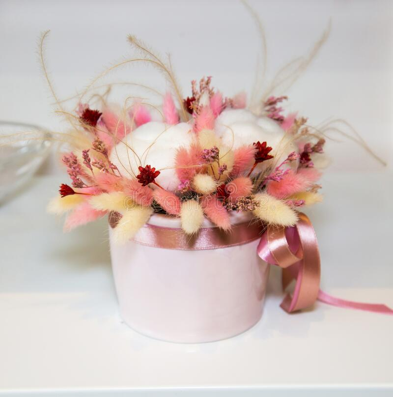 A Bouquet Of Dried Flowers Made Of Cotton Boxes