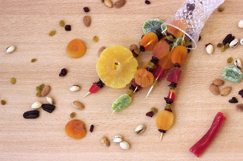 Colorful dried fruits for the Jewish holiday of Tu Bishvat. Bouquet of dried fruits in a vase on a wooden table background for the Jewish holiday of Tu BiShvat stock photography