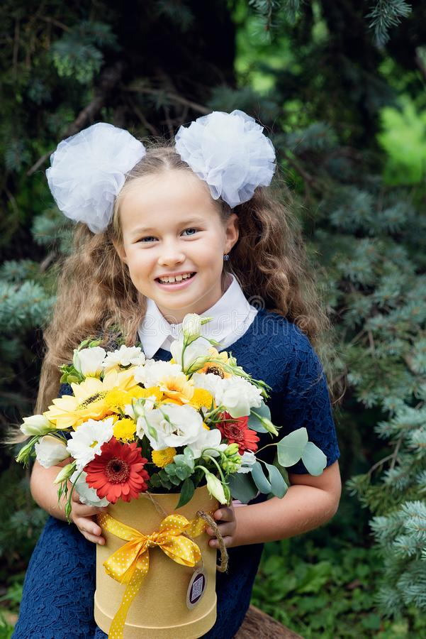 bouquet for first beloved teacher on first of September. Flowers for the last bell. day of knowledge. beginning of the school year royalty free stock images