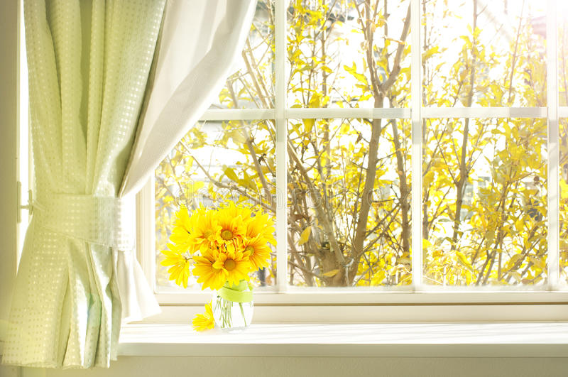 Bouquet of flower on a windowsill. In a fall royalty free stock photography