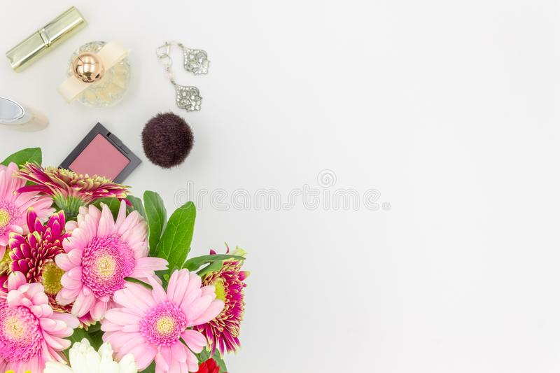 Wedding Bouquet of flowers and beauty products top view on white background space for text royalty free stock images