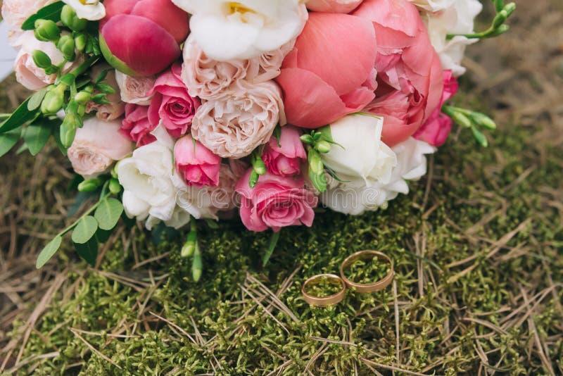 Bouquet of flowers. The bride`s bouquet. Bridal bouquet. Floristics. Wedding rings. royalty free stock photography