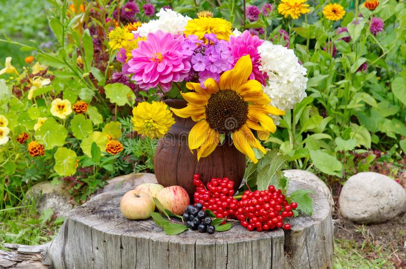 Bouquet of flowers in a clay jug stock image