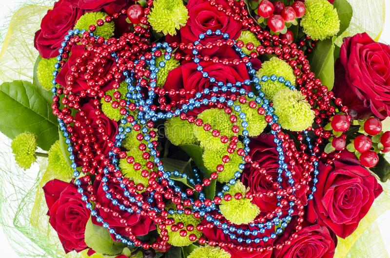 Bouquet of flowers and colored beads for Mardi gras. Studio Photo stock photography