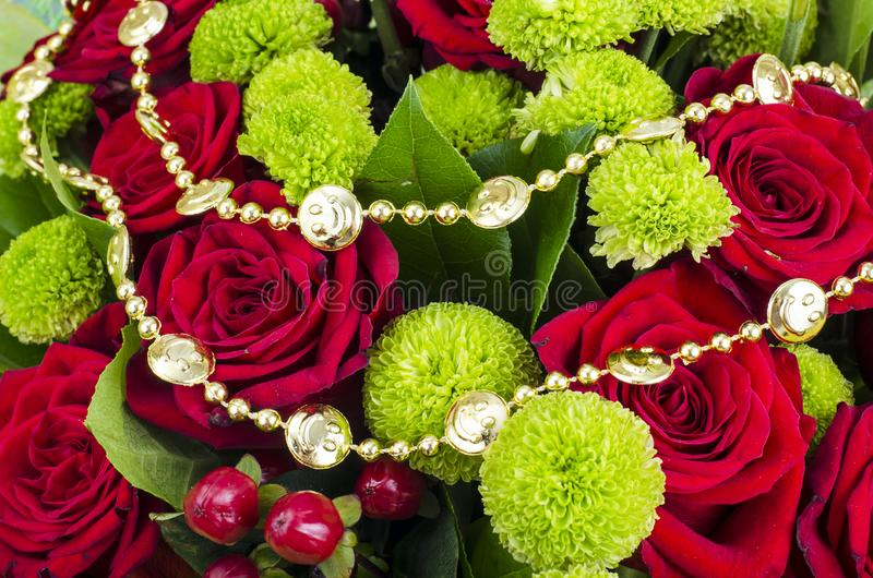 Bouquet of flowers and colored beads for Mardi gras. Studio Photo royalty free stock photography