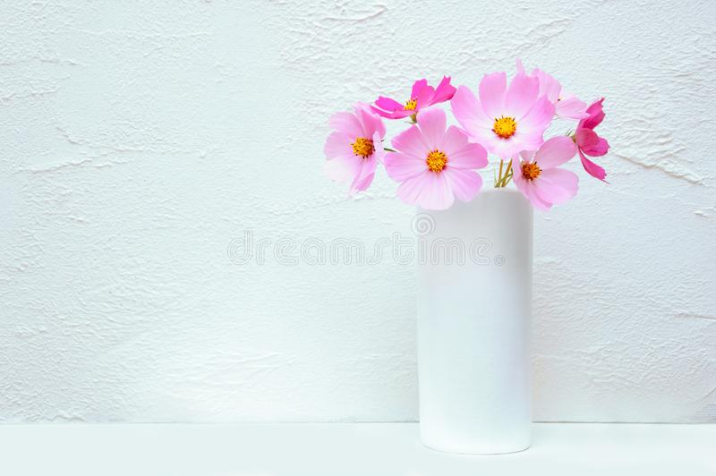Bouquet of flowers Cosme in a white vase. royalty free stock photo