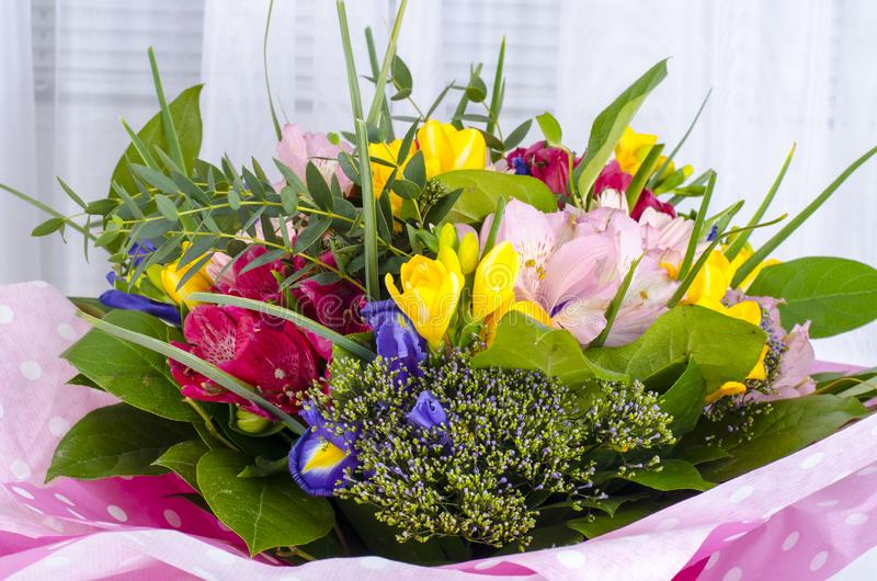 Bouquet of flowers in front of window stock images