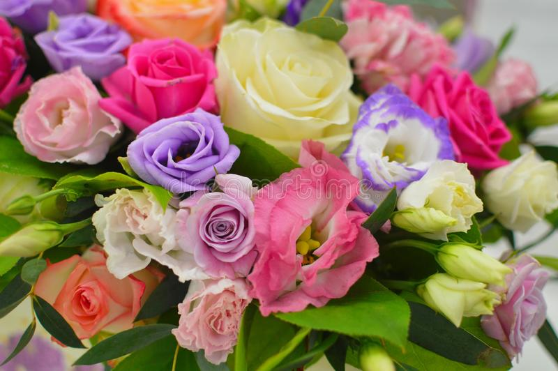 Bouquet of flowers in hat box stock photos