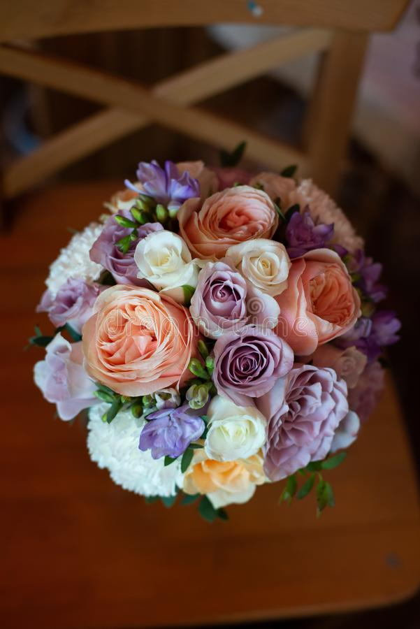 Bouquet of flowers on a leg in the interior of the restaurant for a celebration shop floristry or wedding salon stock photo