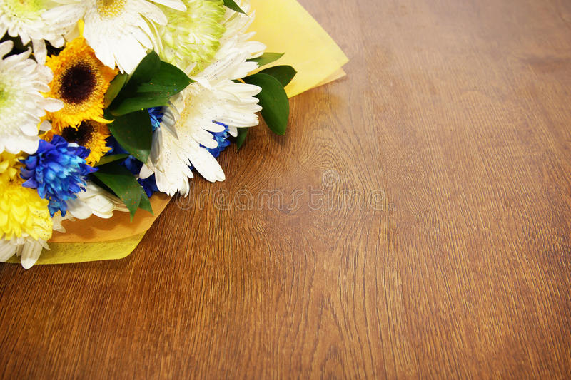Bouquet Of Flowers Lying On A Wooden Surface Stock Photo