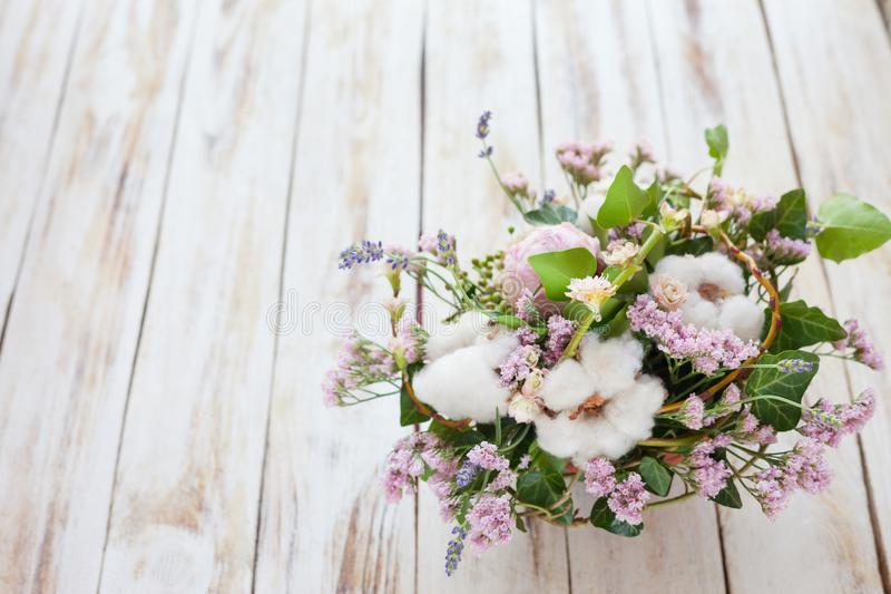 Bouquet of flowers on a old wooden background stock image